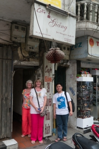Outside Cafe Giang with Son our tour guide